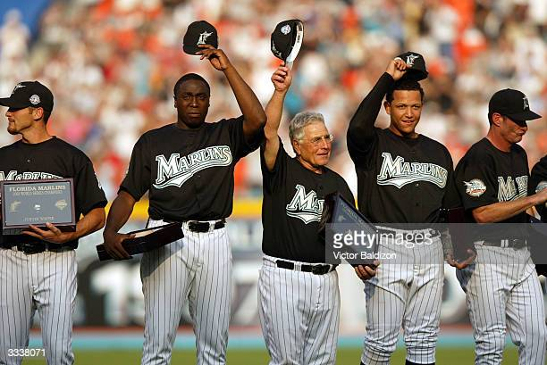 The Florida Marlins celebrate reception of their World Series rings during the game against the Philadelphia Phillies on April 10 2004 at Pro Player...