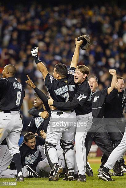 The Florida Marlins celebrate seconds after defeating the New York Yankees during game six of the Major League Baseball World Series on October 25,...