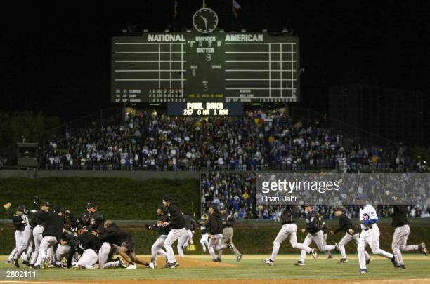 The Florida Marlins celebrate their 9-6 win over the Chicago Cubs during game seven of the National League Championship Series October 15, 2003 at...
