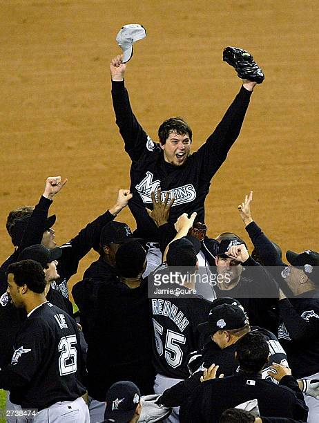 The Florida Marlins hoist up pitcher Josh Beckett the 2003 World Series MVP after defeating the New York Yankees 20 in game six of the Major League...