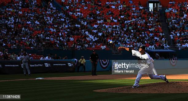The Florida Marlins' Ricky Nolasco throws a pitch in the fading sunlight in the sixth inning against the Washington Nationals The Marlins defeated...