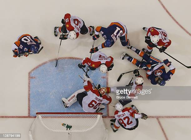The Florida Panthers defend the net against the New York Islanders at the Nassau Veterans Memorial Coliseum on October 8, 2011 in Uniondale, New...