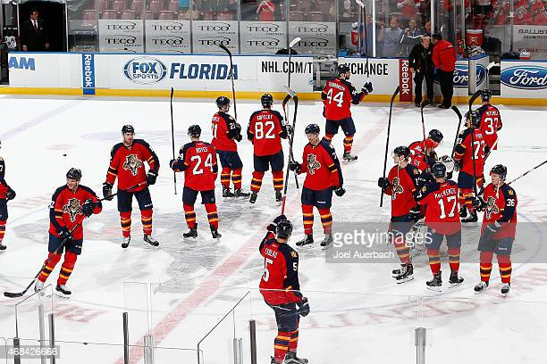The Florida Panthers raise their sticks at center ice to acknowledge the fans after they defeated the Carolina Hurricanes at the BBT Center on April...