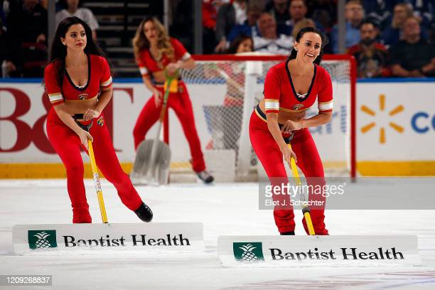 The Florida Panthers Roar Corps clean the ice during a break in the action against the Toronto Maple Leafs at the BB&T Center on February 27, 2020 in...