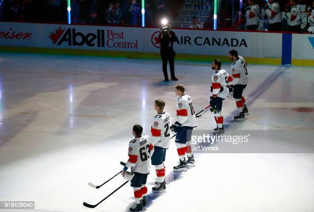 The Florida Panthers stand for a moment of silence in honour of the Parkland shooting before their NHL game against the Vancouver Canucks at Rogers...
