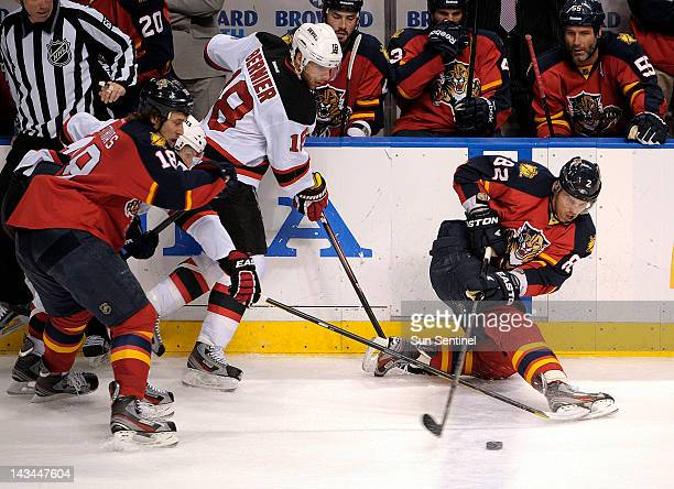 The Florida Panthers' Tomas Kopecky right tries to gain control of the puck against the New Jersey Devils during the first period of Game 7 of the...