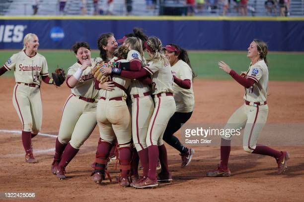 The Florida St. Seminoles celebrate their win during the seventh inning of Game 14 of the Women's College World Series against Alabama on June 07,...