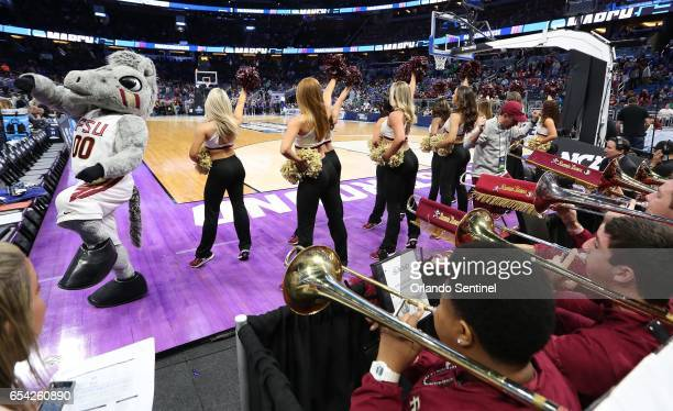 The Florida State band cheerleaders and mascot perform against Florida Gulf Coast during the first round of the NCAA Tournament at the Amway Center...