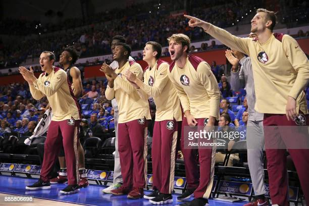 The Florida State bench cheers after a score during a NCAA basketball game against the Florida Gators at the Stephen C O' Connell Center on December...