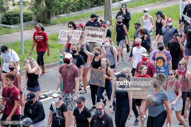 The Florida State Football Team lead a unity walk on June 13, 2020 in Tallahassee, Florida. Florida State players and members of the football...