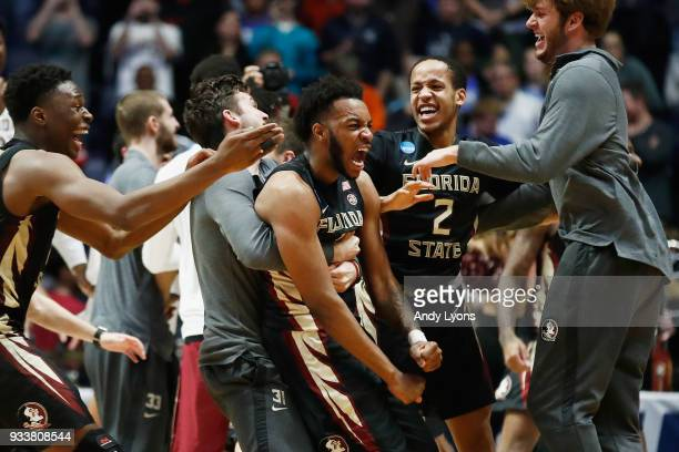 The Florida State Seminoles celebrate after defeating the Xavier Musketeers in the second round of the 2018 Men's NCAA Basketball Tournament at...