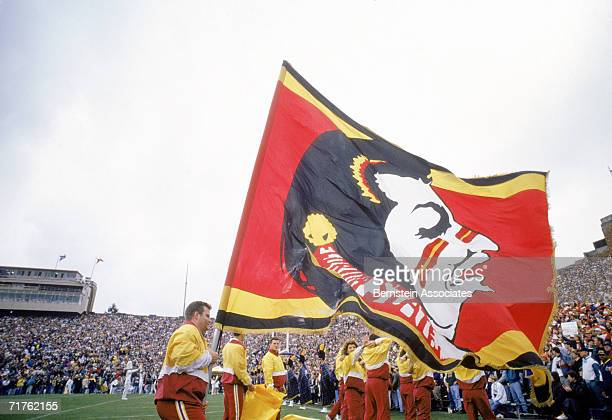 The Florida State Seminoles cheer team flies the school banner before game action against the Notre Dame Fighting Irish on September 28, 1991 at...