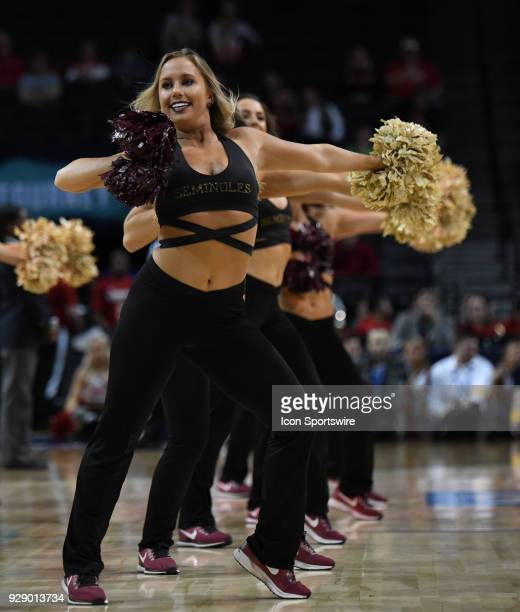 The Florida State Seminoles cheerleaders perform during the ACC men's tournament game between the Louisville Cardinals and the Florida State...