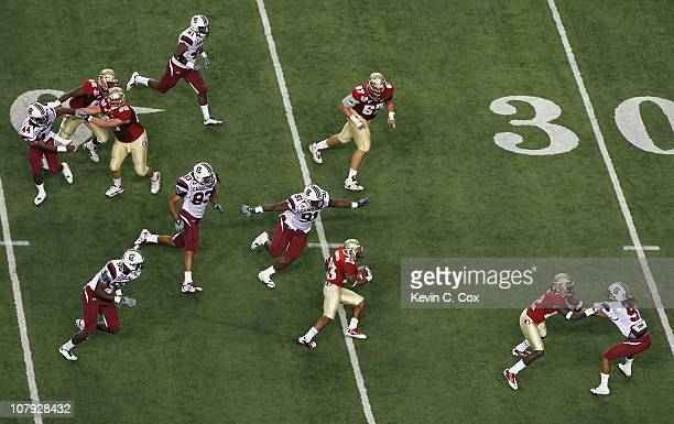 The Florida State Seminoles offense attacks the defense of the South Carolina Gamecocks during the 2010 ChickfilA Bowl at Georgia Dome on December 31...