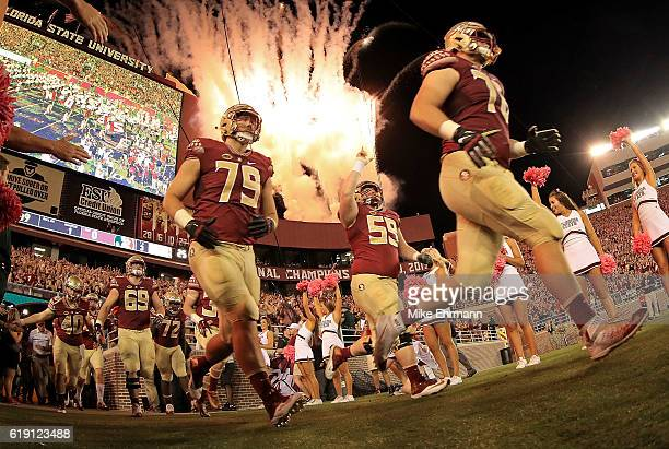The Florida State Seminoles take the field during a game against the Clemson Tigers at Doak Campbell Stadium on October 29 2016 in Tallahassee Florida