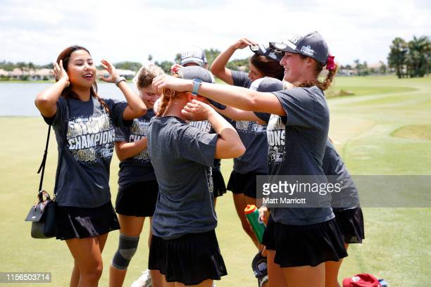 The Florida Tech Panthers celebrate their victory during the Division II Women's Golf Championship held at the PGA National Resort-Champions Course...