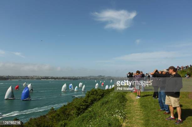 The flotilla of yachts head out to sea at the start of the Coastal Classic Yacht Race in Auckland Harbour on October 21 2011 in Auckland New Zealand...