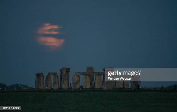"""The Flower Moon sets over Stonehenge on May 26, 2021 in Amesbury, United Kingdom. May's full moon, the """"Flower Moon"""" will be the biggest and..."""