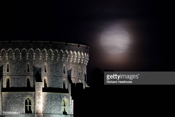 The Flower Super Moon rises over Windsor Castle on May 07 2020 in Windsor England A supermoon occurs when the moon reaches its closest position to...