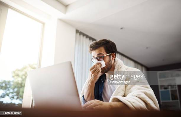 the flu has got him working from home today - illness stock pictures, royalty-free photos & images