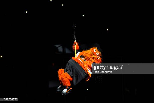 The Flyers mascot Gritty makes his entrance to Wrecking Ball lowered from the ceiling before the NHL game between the San Jose Sharks and the...