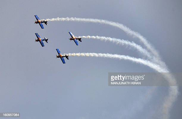 The 'Flying Bulls' considered one of the world's leading aerobatic display teams from the Czech Republic perform on the third day of Aero India 2013...
