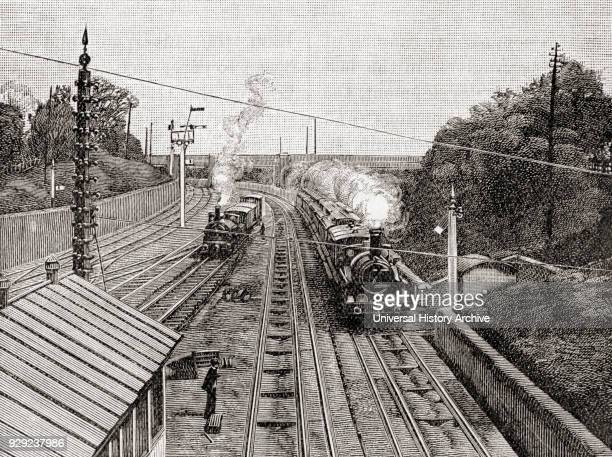 The Flying Dutchman right passing Acton station London England on the Great Western Railway at sixty miles an hour in the 19th century The Great...