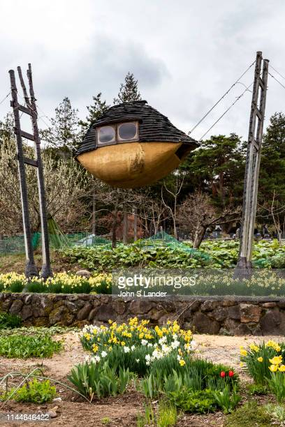 The Flying Mud Boat is a mysterious building with trees protruding from the roof. The four protruding wooden pillars are made of locally-made trees,...