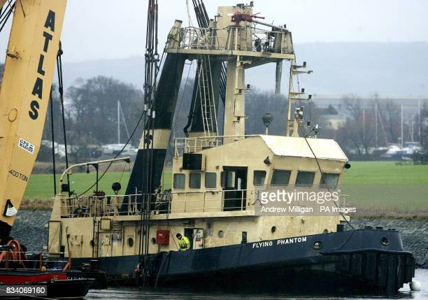 The Flying Phantom tug is visible as the barge GPS Atlas continues its salvage operation on the river Clyde The Flying Phantom tug sank claiming the...