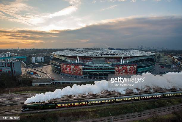 The Flying Scotsman passes the Emirates Stadium on the East Coast Mainline in Holloway on February 25 2016 in London England The majestic steam...