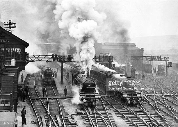 The Flying Scotsman pulled by an A3 class 460 locomotive number 4475 Flying Fox leaving King's Cross station about 1930 Several other passenger...
