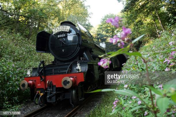 TOPSHOT The Flying Scotsman steam locomotive travels along the East Lancashire Railway's line near Ramsbottom station near Bury northern England on...