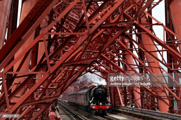 The Flying Scotsman steam train crosses the Forth Rail Bridge as it tours the country