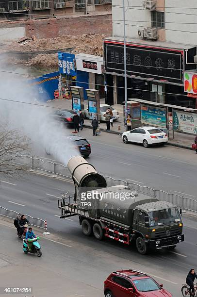 The fog cannon is shooting spray in the air to remit the air pollution on 06th January 2015 in Zhengzhou Henan China