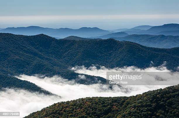 The fog hangs in the valleys along the Blue Ridge Parkway on October 6 2015 near Asheville North Carolina Named one of the 'Top 10 Great Places to...