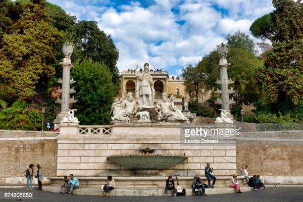 The 'Fontana della Dea Roma' fountain is seen at Piazza Del Popolo on October 31 2017 in Rome Italy Rome is one of the most popular tourist...