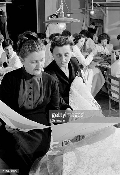The Fontana sisters Zoe and Micol look at some of the lace that will be used to make Margaret Truman's wedding dress The Rome fashion house will not...