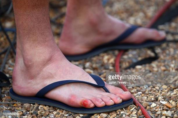 The foot of John Isner of USA is seen as he is interviewed on Day Four of the Wimbledon Lawn Tennis Championships at the All England Lawn Tennis and...