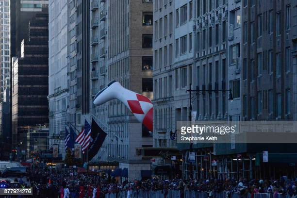 The foot of Power Ranger balloon turns a corner during the annual Macy's Thanksgiving Day parade on November 23 2017 in New York City The Macy's...