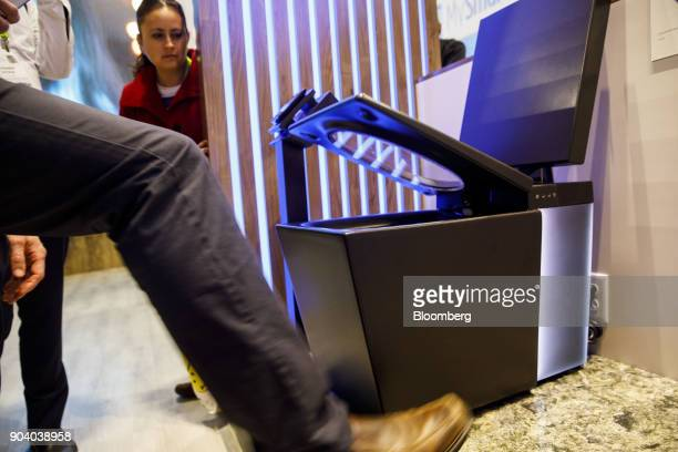 The foot sensor controlled seat raising feature of the Kohler Co Numi intelligent toilet is demonstrated at the 2018 Consumer Electronics Show in Las...