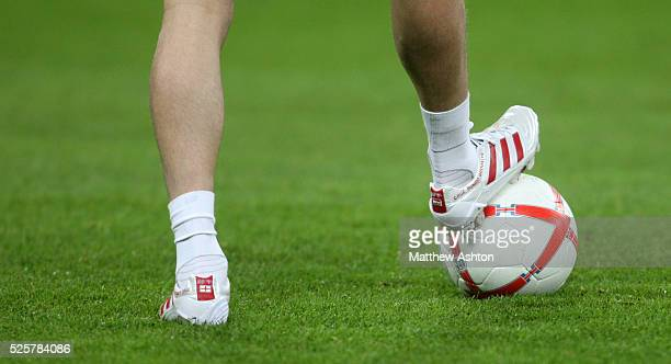 The football boots of David Beckham of England with names of his childen Curz Romeo and Brooklyn resting on an official matchball