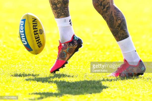 The football boots of Dustin Martin of the Tigers are pictured during a Richmond Tigers AFL training session at TIO Stadium on August 21, 2020 in...