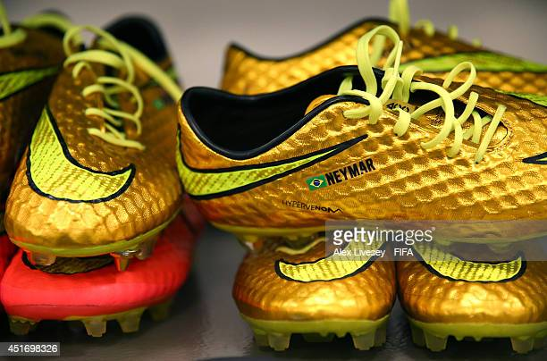 The football boots worn byNeymar of Brazil are displayed in the dressing room prior to the 2014 FIFA World Cup Brazil Quarter Final match between...
