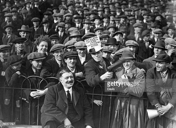 The football crowd at Fulham's Craven Cottage stadium in one of the final rounds of the F A Cup competition The sign on one fans hat reads 'Up Fulham...