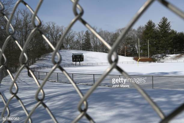 The football field of Newtown High School lies snowcovered during the National School Walkout on March 14, 2018 in Sandy Hook Connecticut. Several...