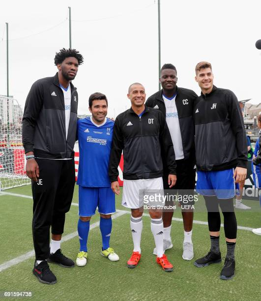 The football legend Deco and David Trezeguet pose with the basketball players Clint Capela Joel Embiid and Juan Hernagomez during the Ultimate...