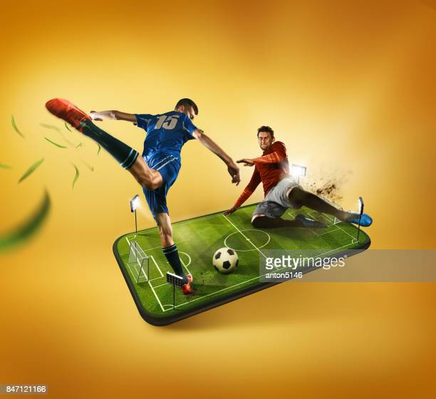 the football players in action on the phone, mobile football concept - match sportivo foto e immagini stock