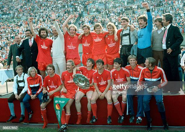 The football team of Bayern Munich celebrates with the trophy winning the German Championship 1981 after the Bundesliga match between Bayern Munich...