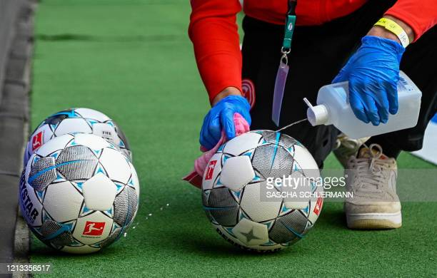 The footballs are disinfected during the German first division Bundesliga football match Fortuna Dusseldorf v SC Paderborn on May 16 2020 in...