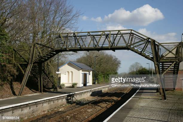 The footbridge at Menheniot station Cornwall with waiting shelter beyond 10th April 2006